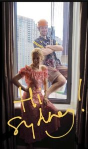 kylie minogue photobombed by window cleaner