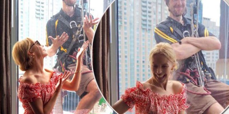 Kylie Minogue photobomb by window cleaner