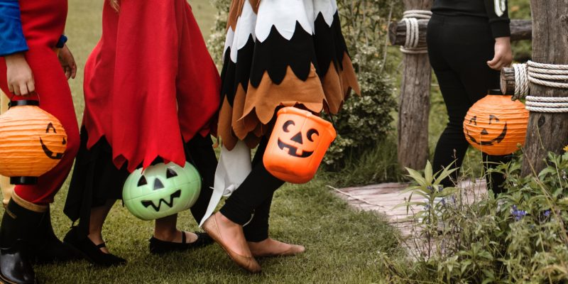 Trick or Treaters going trick or treating on halloween. Treat yourself with E-Z Window Services