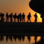 War Veterans Boarding Airplane